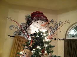 Unlit Christmas Tree Toppers by Bought This Snowman Head And Added Alot Of Sparkly Sprigs And Wa