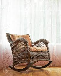 Brown Wicker Rocking Chair Against The Window's Curtains, Indoor.. Hcom Modern Wood Rocking Chair Indoor Porch Fniture For Living Room Whitegray With Cushion Belham Baylor Chairs On Northbeam White Acacia Outdoor Fire Island Swivel Rocker Costway Solid Patio Single Amazoncom Glider Mid Century Traditional Slat Dark Brown Coral Coast Inoutdoor Mission Black Acapulco In Yellow Walnut Resin Wicker Set Of 2 Wicker Rocking Chair Against The Windows Curtains Indoor