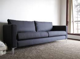 karlstad couch in dark grey with metal legs interior