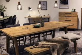 Stylish Modern Dining Room Wooden Table Bench And Drawers Gray Rugs Black Pendant Lights Desk Lamp