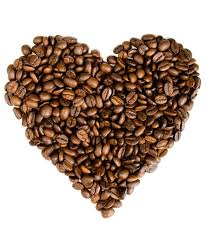 Roasted Coffee Beans In The Shape Of Heart On White Background