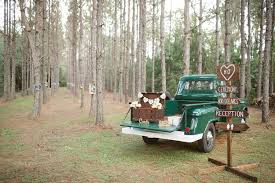 Rustic Outdoor Wedding Directional Sign With Vintage Trunk For Gifts On Green Pick Up