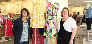 Long Time Store Associate Kathy Krueger Left And Manager Jennifer Anderson Stand In Front Of A Display At The Medford Outlet Centers Dressbarn
