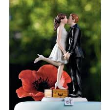 A Kiss And Were Off Wedding Cake Topper
