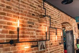 Download Restaurant Rustic Walls Vintage Interior Design Lamps Metal Pipes And Light Bulbs Stock