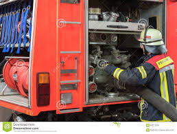 Firefighter In Action And Connected A Fire Hose On The Fire Truck ... Truck Firefighters Hose Firemen Blaze Fire Burning Building Covers Bed 90 Engine A Firetruck Stock Photos Images Alamy Hose Pipe And Truck Vector Image 1805954 Stockunlimited American Fire With Working V10 Modhubus National Reel Kids Pedal Filearp2 Zis150 Engine Tender Frontleft Viewjpg Los Angeles Department 69 An Attached Flickr Fire Truck Photo Unique Crown Wagon Filenew York City Fighter Pulling Water From