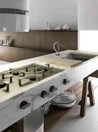 Kitchen Island With Cooktop And Seating 39 Smart Kitchen Islands With Built In Appliances Digsdigs