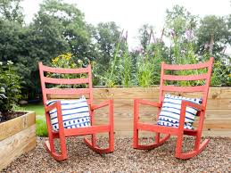 Red Rocking Chairs In Outdoor Living Space | HGTV Charleston Acacia Outdoor Rocking Chair Soon To Be Discontinued Ringrocker K086rd Durable Red Childs Wooden Chairporch Rocker Indoor Or Suitable For 48 Years Old Beautiful Tall Patio Chairs Folding Foldable Fniture Antique Design Ideas With Personalized Kids Keepsake 3 In White And Blue Color Giantex Wood Porch 100 Natural Solid Deck Backyard Living Room Rattan Armchair With Cushions Adams Manufacturing Resin Big Easy Crp Products Generations Adirondack Liberty Garden St Martin Metal 1950s Vintage Childrens