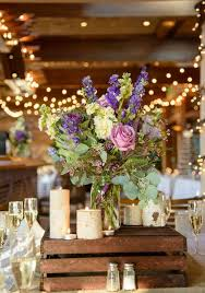 Rustic Mason Jar And Wood Wedding Centerpieces