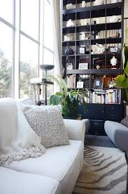 an ikea hack of epic heights a sky high stacked bookcase