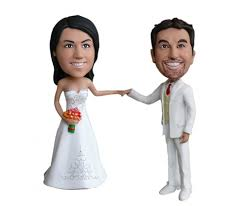 personalized wedding cake topper of a wedding couple in white 1