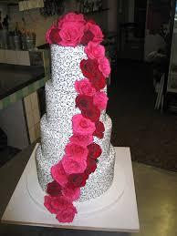 Yashfa s black & white filigree wedding cake with pink & red Roses
