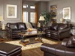 Living RoomRustic Room Design Ideas With Luxury Black Leather Sofas And Glass Table