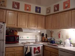 Fat Chef Kitchen Decor With Wall Art Prints Above Cabinets