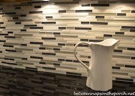 kitchen remodel with lowes glass tile backsplash black