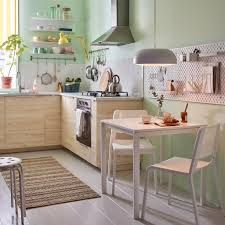 A Small Beige Green And White Kitchen With MELLTORP Table Two Stackable