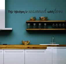 blue kitchen wall design with wooden shelf and wooden materials