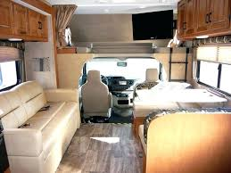 Motorhome Interiors Woman Cooking In Camper Interior Family