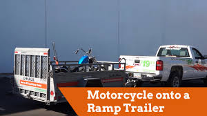 How To Load A Motorcycle Onto A Ramp Trailer - YouTube