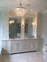 Ivory Master Bathroom Features A Robert Abbey Bling Chandelier Illuminating Cabinets Topped With Gray Marble Fitted His And Hers Sinks Under