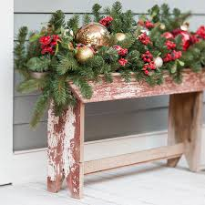 Rustic Wooden Bench Near The Front Door Decorated With Greenery And Ornaments
