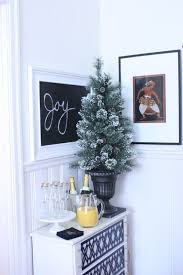 Decorating A Small Apartment For Christmas Potted Tree On Beverage Table