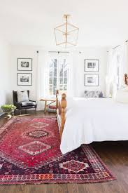 Bedroom White Walls Bedding Antique Rug Seating