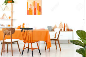 Three Different Chairs Placed By The Long Dining Table With Orange ... Unique Zeppelin Modern Orange Ding Chair All World Fniture Room Chairs Thrghout Ppare Dennisbiltcom These Will Convince You To Go Midcentury Mariette Set Of 2 Intercon Classic Oak 7piece Solid Pedestal Miniature Hutch Table Two Antique Etsy Kenneth Fabric Hot Orange Ding Room Set Schuhekeflyknitlunar3top Cattail Bungalow 96 Warm Amber Extendable Trestle With Chairs Design Ideas