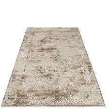 großer beiger teppich im boho style mit unregelmäßiger musterung