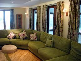 green fabric sofa on the floor and green fabric curtains connected