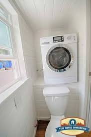 A Ventless Washer Dryer Combo In Tiny House Bathroom At The