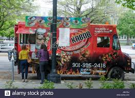 A Food Truck In The Foggy Bottom Neighborhood Of Washington, DC ... Dcs Burdensome Food Truck Regulations Economics21 Hal Grill Washington Dc Trucks Roaming Hunger Best Cities In America Drive The Nation Images Collection Of Theme Ideas And Inspiration Mgarets Soul Catering Nationwide Challenge Proposed Phation 15 Photos 59 Reviews Shaw Trucks Line Up On An Urban Street Usa Stock Association Responds To Tourists Get Food From The At Dine Drink Vegfest 2016 Sweet Success