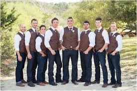 Rustic Groomsmen Attire With Jeans Boots And Vests