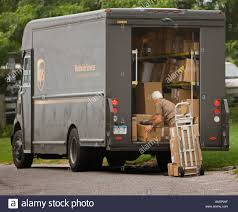 100 Ups Truck Worker Unloading Packages From A UPS Truck Stock Photo 8812062 Alamy