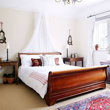 Bedroom With Sleigh Bed White Walls And Neutral Carpet