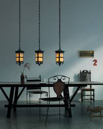 Triple Lantern Hanging Light For Traditional Dining Room Lighting Accent Over Black Wooden Sawhorse Table