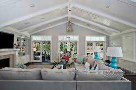 lighting for vaulted ceilings family room contemporary with none