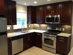 dark kitchen cabinets with light floors glass stainless steel