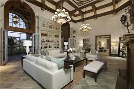 Traditional Living Room With Slate Floor Tiles And Dual Chandeliers Part 63