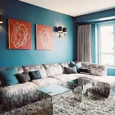 Living Room Teal Decorating Ideas With Armless Sofa And Wall Arts Sconces Mirrored Cofee