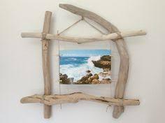 cadre photo en bois flotté par l atelier de corinne décorations