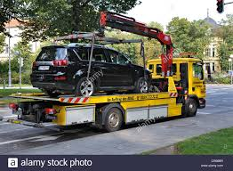 Tow Truck Towing Car Stock Photos & Tow Truck Towing Car Stock ... Home Matchett Towing Recovery Pensacola Tow Truck Jerr Dan Trucks Nashville Tn Rembrance For Driver Killed In Train Crash Quality Preowned Dodge Dakota At Eddie Mcer Automotive Quality Car Stock Photos Uniforms Ud Bobs Auto Repair Types