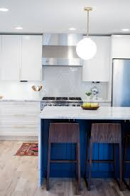 mid century modern kitchen remodel with white cabinets navy