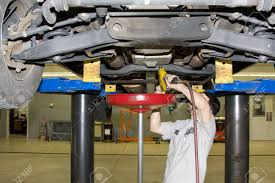 Mechanic Removing Transmission Fluid From Pickup Truck, Transmission ... Truck Transmission Repair Trustedrepairca Medium Duty Plainfield Naperville South West Chicagoland Repairs Rebuild Lotus Logistics Inc Service Cost And Differential Heavy Maintenance With Certified Mechanics In 92779054 San Listings Atw Auto Sales La Sierra Salt Lake The Strongest Dodge Ever Built Diesel Power Magazine Aamco Colorado Coolers Install