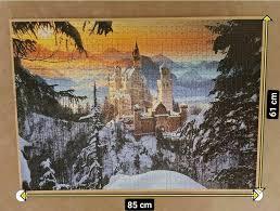 schloss neuschwanstein puzzlebild auf holzplatte