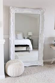 Ornate Floor Mirror In An All White Bedroom