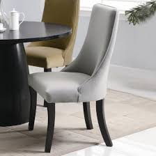 Parsons Dining Chairs Upholstered by White Tea Pot On Black Round Table Closed Gray Chair On Carpet