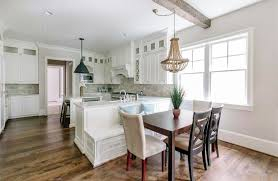 Kitchen With Dining Peninsula Built In Bench Seating Next To Rustic Wood Table