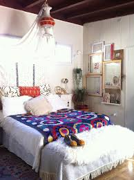 Dreamy Canopy Ethnic Patterns And Mixed Art In Mismatched Frames Make This Bedroom Looks