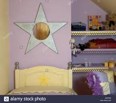 Mauve Bedroom by Star Shaped Mirror Above Bed In Child U0027s Mauve Bedroom With